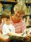 Grandmother reading to young child