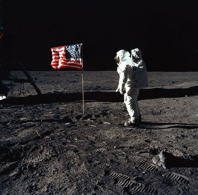 Buzz Aldrin and American flag on moon's surface