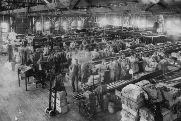 Interior of Glendora fruit packing house including workers