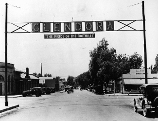 Foothll Blvd Looking West, Glendora sign mounted as an arch over the street