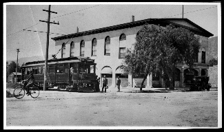 Pacific Electric (PE) car in front of the First National Bank Building and Opera House