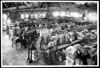 Vintage picture of people inside Glendora fruit packing factory